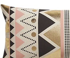 A Pillow in the Perfect Palette: Rose and gold get together on a statement-making geometric pillow. via @domainehome