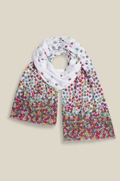Inspired by Scandinavian Folk Tapestry, our Scattered Flowers Border Scarf offers a sense of free spirit with the gradual fade from white to a fill floral design. The colourful bold print is finished with frayed edges, perfectly paired with any outfit!
