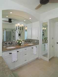 love the full length mirror, and the tile choices, and the fixtures.  also love the light fixtures installed directly onto the mirror.  gorgeous.