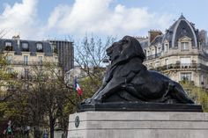 """The pretty Place Denfert-Rochereau is so close to one of the """"darker"""" sights of Paris"""