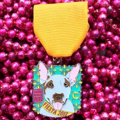 2017 The Cannoli Fund Dog Fiesta Medal - $10 Auggie, a Bull Terrier mix, is the star of our dog Fiesta San Antonio medal this year!