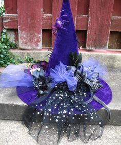 Purple and Black / Witch Hat / with Skulls / Black Roses and Glittery Spiders / Feathers / Halloween Centerpiece / by English Rose Designs. $69.99, via Etsy.