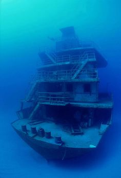The abandoned 300' Odyssey off the north coast of Roatan in the Caribbean. Roatán, located between the islands of Útila and Guanaja, is the largest of Honduras' Bay Islands.
