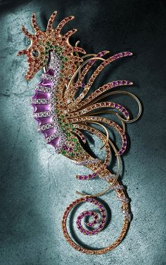 Seahorse Brooch  The vibrant colors and detailed design of this imaginatively colored creature, coupled with incredibly detailed setting work and unusual combination of stones, gives our seahorse the bright and bold feel of the most beautiful undersea life.