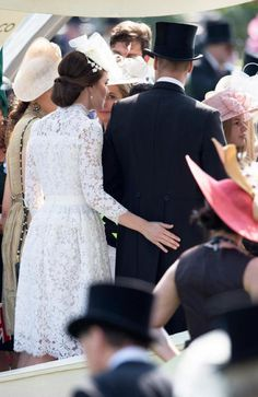 Kate gives husband William a right royal bum-pat. Picture: The Sun