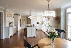 Kitchen Design White Floor To Ceiling Kitchen Cabinet And Recessed Ceiling Lighting Also Black Granite Countertop Kitchen Island With Seating Under White Drum Shade Pendant Lamp In California Kitchen Design The Gorgeous California Design for Your Kitchen