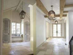 Jill Sharp Brinson This dual photo presents the house's mudroom on the left and the entry hall on the right. Jill selected Peacock Pavers for the flooring amid a complimentary palette of neutrals. I like her selection of lighting as well.