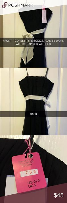 Black Mori Lee Dress This is a brand new, never been worn, black dress that can be worn as a sundress or as a semi-formal dress. It comes with straps or can be worn strapless. It's a gorgeous dress with a corset style bodice. It's more of a size 30 bust.   Thanks for looking and happy shopping!  Please check out my other items for sale!    All of my items come from a smoke free home and are well cared for. Mori Lee Dresses Strapless