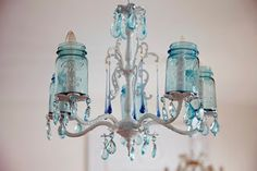 antique canning jars reuse | very retrofitted chandelier - I love all the blue glass accents