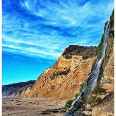 """Discovered by John Flores, """"Follow the Coast Trail to reach the Alamere Falls, a waterfall which jets down onto the beach. The hike from the parking lot and back takes 4 hours. Again, the Alamere Falls trail is unmaintained and the area is filled with Poison Oak, so I'd advise wearing long sleeves. To get down to the beach from this shorter trail, you have to climb down a pretty steep cliff with some loose rock, so be extremely careful."""" at Palomarin, Alamere Falls, Marin County, California"""