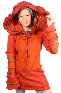 This saffron-hued tunic is extra long and features a striking multi-ruffle hood with a cute little chin tie.