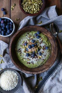 Superfood Green Smoothie Bowl with avocado, greens, cacao nibs, and blueberries | TheRoastedRoot.net #healthy #breakfast #snack