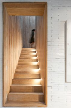 Wooden staircase with side lights.