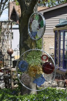 2 Bicycle Rims feature interesting colored glass pieces; each will turn separatly in the wind