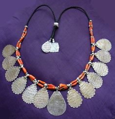 A stunning collection of Amulets with protective writings combined with beautiful branch coral