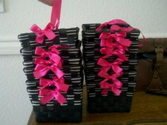 Cute pink ribbon tied on black baskets