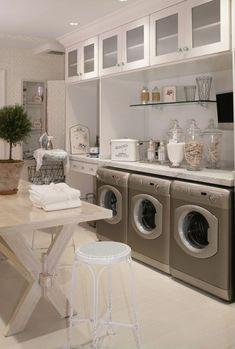 Traditional Laundry Room with Glazed porcelain floor tile, Glass door cabinets, Floating glass shelf