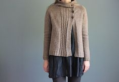 """""""Clouds in my Coffee"""", a seamless, top-down asymmetrical cardigan knit out of worsted-weight yarn."""