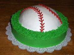 baseball cake - use a ball pan on top of a double 10in round. All buttercream icing- easy and fun cake to do!