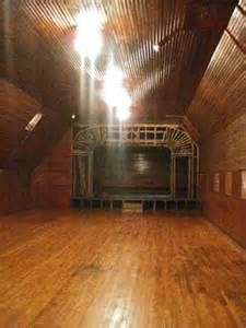 The attic, accessed via a staircase in the third floor servants wing, contained a raised proscenium stage complete with electric dimmer lights and soundboard. The Hill children used the space as a theater and playroom, and grandchildren recalled this area had gymnastic equipment, a large grand piano, and trunks with costumes. Opposite the stage is where the Hill family would store some of their belongings (cedar cupboards for changing out seasonal clothes, perhaps?).