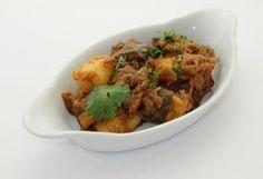 Aubergine and potato curry - in a rich tomato masala