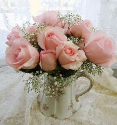 Vintage Shabby Pink!   Notice how babys breath is used!!!! Love this in the dainty vase