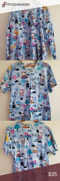 """Hello Kitty Women's Multi-color Scrub Set Hello Kitty Asian theme scrub and scrub warm up jacket.  Scrub top has mock wrap front. 2 front patch pockets. Self back tie. Side vents. Chest 24"""". Length 16"""" from arm pit. Warm up jacket has button down snap closure. 2 front pockets. Round neck. Knit cuff sleeves. Chest 24"""". Fashionable scrub set. New without tags. Sanrio Tops"""