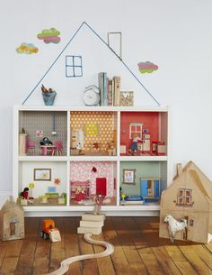 "doll house in a set of bookshelves. GREAT waldorf idea; then use them for books later. different ""roof"" though. maybe against a chalkboard painted wall, so that scene could change??"