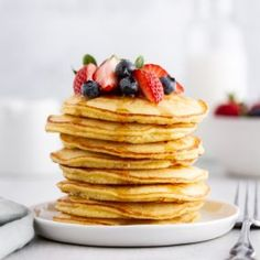 Fluffy Coconut Flour Pancakes Recipe -- these simple and delicious paleo, dairy free and gluten free pancakes are begging to be your next breakfast. girlversusdough.com @girlversusdough #girlversusdough #paleobreakfast #lowcarb