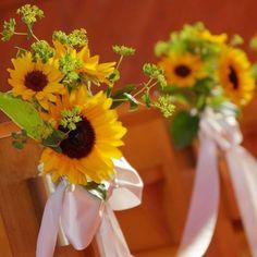 プリティチャペル大宮店|結婚式場写真「【70,200円でできる結婚式】季節のお花をコーディネイトするのも素敵です。夏の結婚式ではひまわりのアレンジもかわいらしい。 」 【みんなのウェディング】