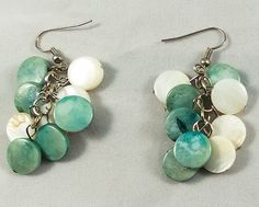These are beautiful green and white mother of pearl earrings. They measure at 4.5 cm.