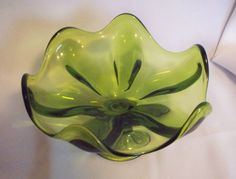 VIKING ART  GLASS EPIC GREEN STEMED BOWL...found at thrift store with matching candleholders for $2...was good day for treasure hunting.....
