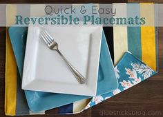 Reversible Placemat Tutorial: These placemats and so incredibly easy to whip up! No bias tape or batting required. Pick up 2 yards of your favorite coordinating canvas fabric and you'll have a set of 6!
