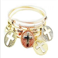 1 Left💖 Individual Gold Cross Bracelet Gorgeous and Beautiful. Price is each price. The picture shows many of the bracelets worn together to give the layered effect. I received 2 single bracelets in gold with the silver cross. Gorgeous. Jewelry Bracelets