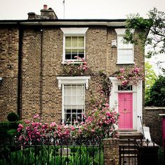 Pink door & roses from How To Choose The Perfect Front Door Colour For Red Brick Houses over on Modern Country Style