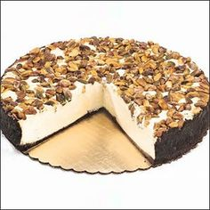 Catch the gourmet splendor of our White Chocolate Pistachio Knockout Cheesecake.