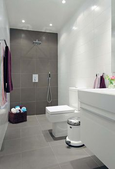 Large Square Tile , White wall Tile White Grout ,Looks great simple layout but effective in style.