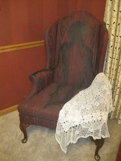 One of my favorite props.  A garage sale chair, used red latex paint mixed with a medium.  Then painted this faded ghost using black paint.