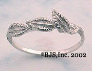 """Sterling Silver Nenya Tracer Band - Lord of the Rings by Lord of the Rings. $24.99. The leaves on the ring are English or European Beech leaves.  The European Beech is a tree much loved by the Elves and JRR Tolkien.  The Nenya Tracer Band is available in US sizes 5 to 13,  in whole and half sizes.   The ring measures approximately 5 mm (just under 1/4"""") from leaf tip to band and the back of the band measures approximately 1.4 mm (1/16"""") wide.  Weighs approximately 1.6 grams..."""