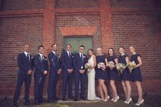 navy blue groomsman's suits and bridesmaid's dresses - photographed by Casey Jane Photography