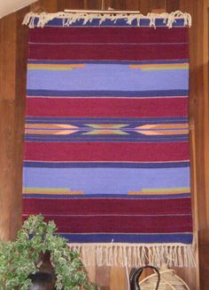 """The Wind Singing in Your Veins"" - Handwoven in the Rio Grande Tradition (Hispanic) with 100% hand-dyed wool on a large floor walking loom.  This style of weaving was brought to the Southwest by Spanish settlers in the 16th century and is traditional to the people of the middle and upper Rio Grande valleys in New Mexico and Southern Colorado, where I make my home.  This style actually derives from the interweaving of the Spanish, Mexican native, and the local Indian pueblo weaving cultures."
