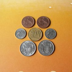 Set of 7 vintage coins from South Africa, all from 60s, 70s, 80s and 90s. By purchasing this listing you will get the following coins: - 5 cents, 1965, 1979, 17 mm diameter; - 5 cents, 1990, 1993 20 mm diameter; - 20 cents, 1983, 1985 23 mm diameter; - 50 cents, 1993, 20 mm.  More vintage coins from all over the world available here: http://etsy.me/1G8XkZn ***************************************** When and how you will get your order?  ♥ All items will be shipped from Ukraine; ...