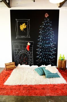 DIY Winter Wall - I created this fireplace and christmas tree by painting an area of wall with chalkboard paint and mounting twinkle lights over the wall drawings - a great solution for people with small spaces