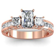 Radiant Trio Diamond Engagement Ring - A combination of Big, Bold & Beautiful comes with this very lovely 14K Rose Gold Radiant Trio Diamond Engagement Ring placed within a Channel setting that features a 1.03 carat White Radiant cut center stone along with thirty-eight additional White Princess cut accent side stones. This Trio style ring comes with an IF in clarity with an H in color & the total gem weight is equal to 1.65 carats. The diamonds are 100% natural. #unusualengagementrings
