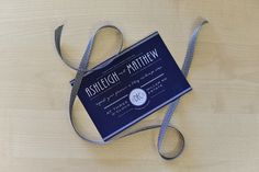 Art Deco styled invite printed in white onto navy card stock