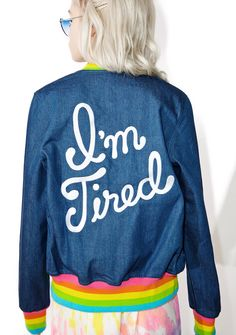 Big Bud Press I'm Tired Denim Jacket ...but still tryna keep a sunny disposition! This dope bomber style jacket features a blue denim construction, slim fit, rainbow rib trim, upside-down smiley patch on tha chest, and big white embroidered lettering reading 'I'm Tired' across the back.