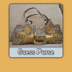 Guess gold purse Guess gold purse with vinyl and snake like material. Some scratches on the medal closure. Guess Bags