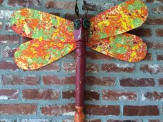 Lava Wings- Dragonfly made from repurposed and recycled materials using table legs and ceiling fan blades. Available at WingingThis.com.