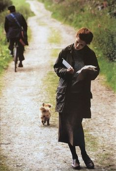 An English Country Lane: Vintage Barbour catalogue shot. Reading a letter