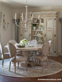 Idée décoration et relooking salle à manger Tendance Image Description Rich cream coloured painted round table with tufted upholstered chairs and a stunning vintage shabby chic French armoire create an inviting and cozy dining room which is casually
